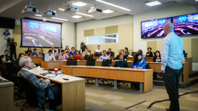 Entrepreneurship event in San Francisco with Philadelphia students on screens.