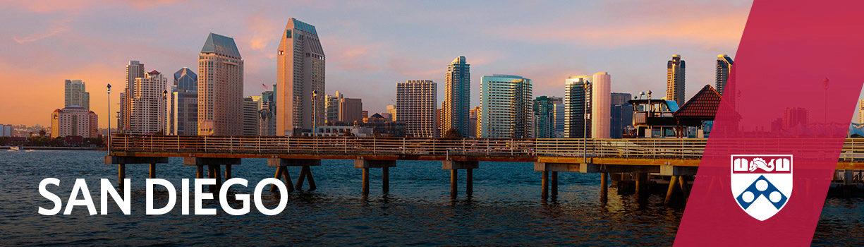 Pier at sunset overlooking San Diego skyline